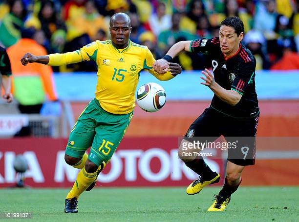 Lucas Thwala of South Africa vies for the ball with Guillermo Franco of Mexico during the 2010 FIFA World Cup South Africa Group A match between...