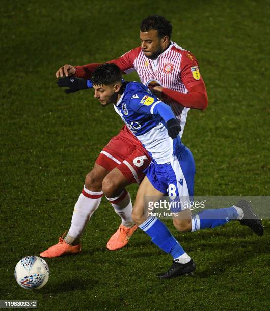 Lucas Tomlinson of Bristol Rovers looks to break past Tom Soares of Stevenage during the Leasingcom Trophy Third Round match between Bristol Rovers...