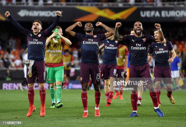 Lucas Torreira Ainsley MaitlandNiles and Alexandre Lacazette of Arsenal celebrate victory after the UEFA Europa League Semi Final Second Leg match...