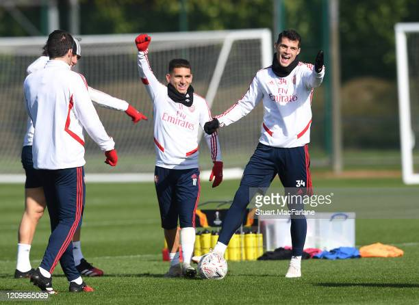 Lucas Torreira and Granit Xhaka of Arsenal during a training session at London Colney on March 01, 2020 in St Albans, England.