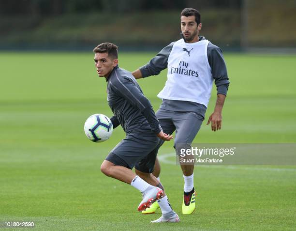 Lucas Torreira and Henrikh Mkhitaryan of Arsenal during a training session at London Colney on August 17 2018 in St Albans England