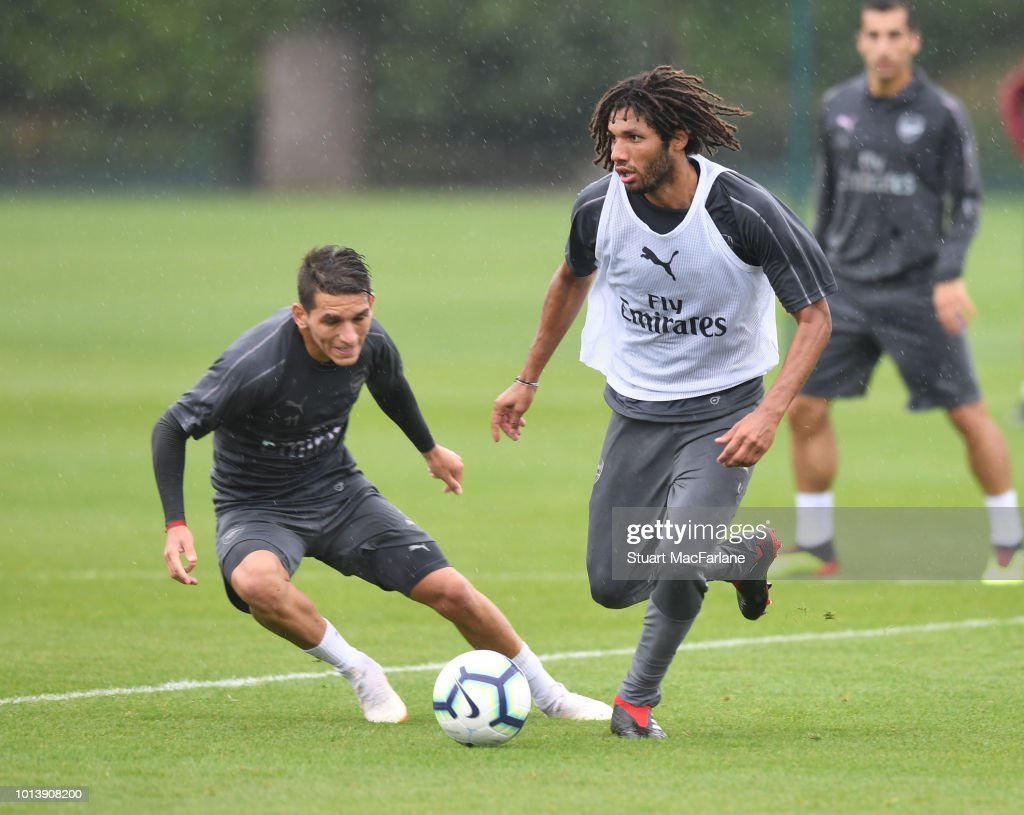 Lucas Torreira and Mo Elneny of Arsenal during a training session at London Colney on August 10, 2018 in St Albans, England.