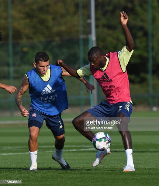 Lucas Torreira and Nicolas Pepe of Arsenal during a training session at London Colney on September 21 2020 in St Albans England