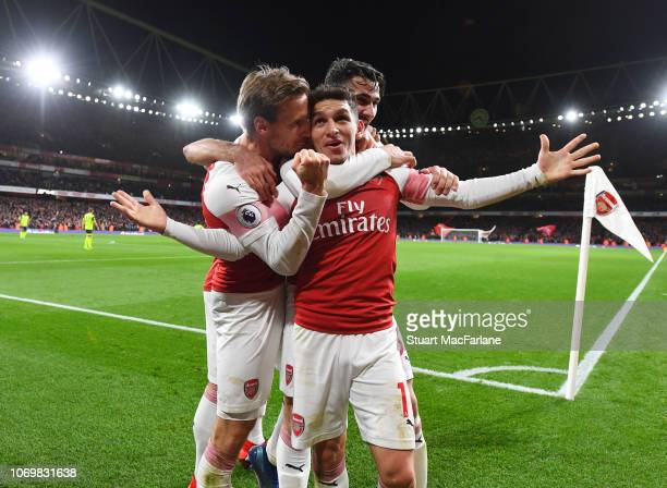 Lucas Torreira celebrates his goal with Nacho Monreal and Sead Kolasinac during the Premier League match between Arsenal FC and Huddersfield Town at...