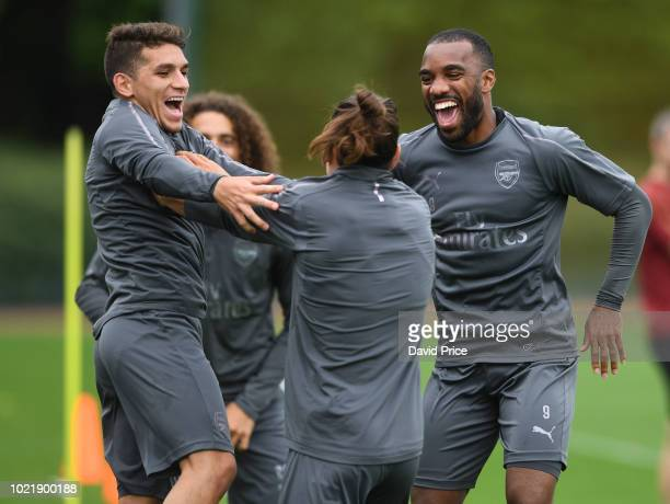 Lucas Torreira Hector Bellerin and Alexandre Lacazette of Arsenal during Arsenal Training Session at London Colney on August 23 2018 in St Albans...