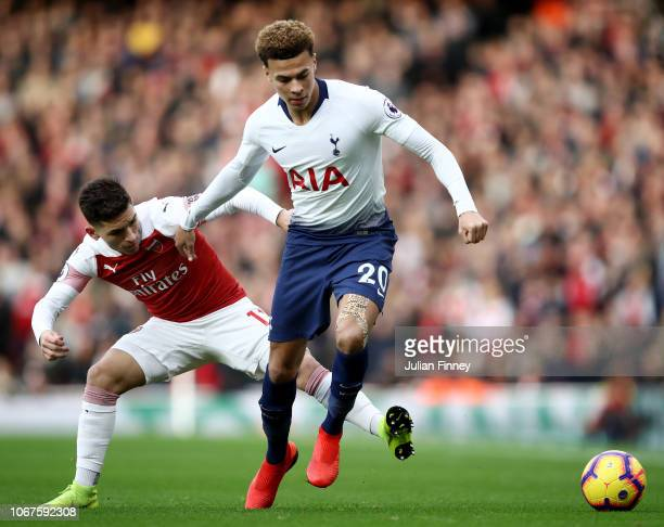 Lucas Torreira of Arsenal battles for possession with Dele Alli of Tottenham Hotspur during the Premier League match between Arsenal FC and Tottenham...