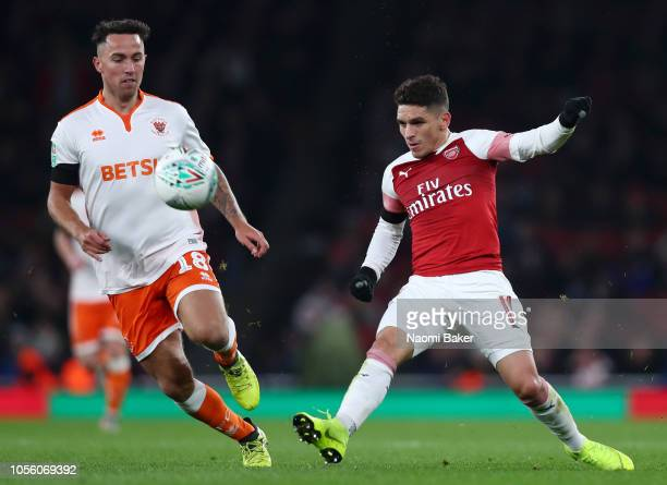 Lucas Torreira of Arsenal battles for possession with John O'Sullivan of Blackpool during the Carabao Cup Fourth Round match between Arsenal and...