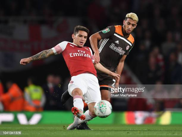 Lucas Torreira of Arsenal breaks past Said Benrahma of Brentford during the Carabao Cup Third Round match between Arsenal and Brentford at Emirates...