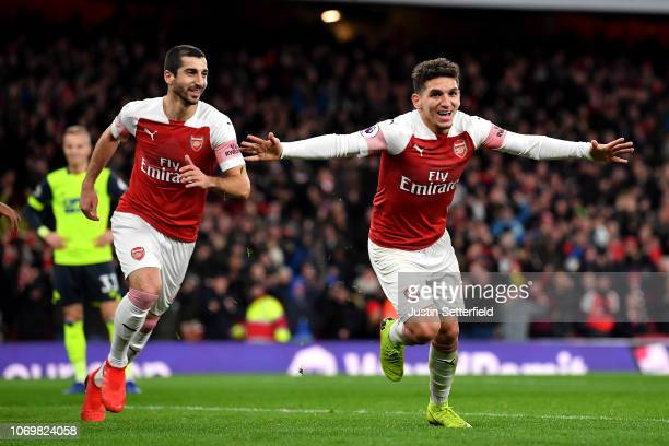 Lucas Torreira of Arsenal celebrates after scoring his team's first goal during the Premier League match between Arsenal FC and Huddersfield Town at...