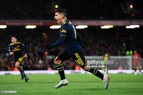 Lucas Torreira of Arsenal celebrates after scoring his team's first goal during the Carabao Cup Round of 16 match between Liverpool and Arsenal at...