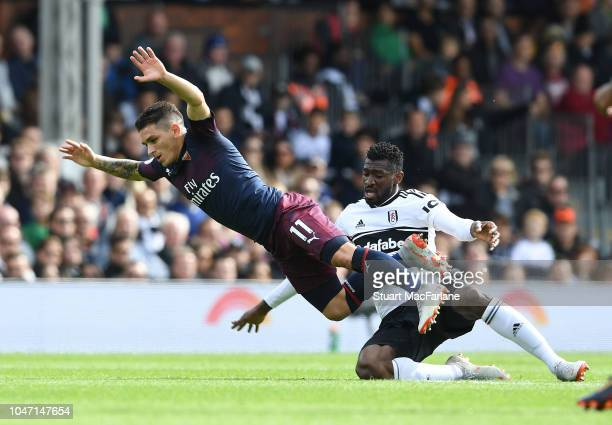Lucas Torreira of Arsenal challenged by AndreFrank Zambo Anguissa of Fulham during the Premier League match between Fulham FC and Arsenal FC at...