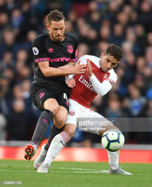 Lucas Torreira of Arsenal challenges Gylfi Sigurdsson of Everton during the Premier League match between Arsenal FC and Everton FC at Emirates...