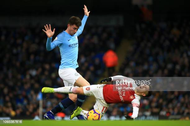Lucas Torreira of Arsenal is challenged by Aymeric Laporte of Manchester City during the Premier League match between Manchester City and Arsenal FC...