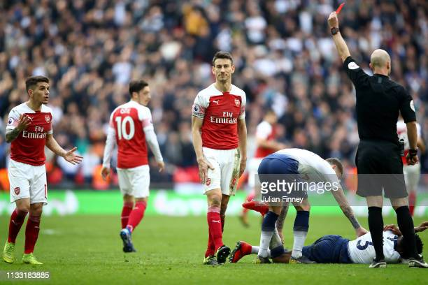 Lucas Torreira of Arsenal is shown a red card by referee Anthony Taylor during the Premier League match between Tottenham Hotspur and Arsenal FC at...