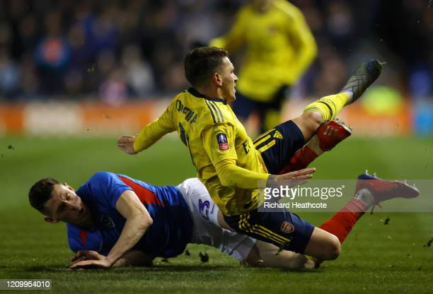Lucas Torreira of Arsenal is tackled by James Bolton of Portsmouth FC which leads to Lucas Torreira being stretchered off due to injury during the FA...