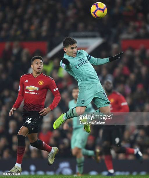 Lucas Torreira of Arsenal outjumps Jesse Lingard of Man United during the Premier League match between Manchester United and Arsenal FC at Old...
