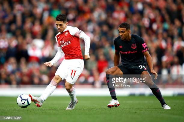 Lucas Torreira of Arsenal passes the ball under pressure from Dominic CalvertLewin of Everton during the Premier League match between Arsenal FC and...