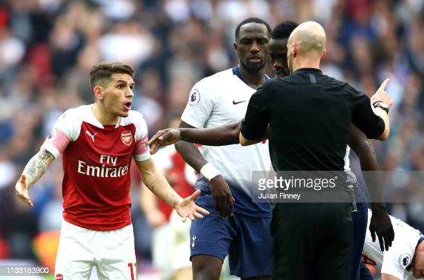 Lucas Torreira of Arsenal reacts after being shown a red card by referee Anthony Taylor during the Premier League match between Tottenham Hotspur and...