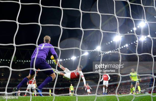 Lucas Torreira of Arsenal scores his team's first goal during the Premier League match between Arsenal FC and Huddersfield Town at Emirates Stadium...