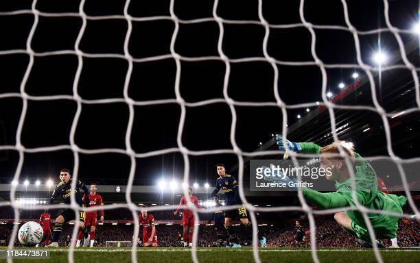 Lucas Torreira of Arsenal scores his team's first goal past Caoimhin Kelleher of Liverpool during the Carabao Cup Round of 16 match between Liverpool...