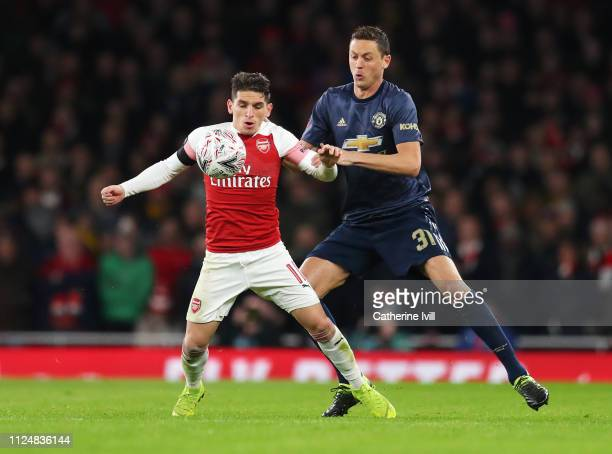 Lucas Torreira of Arsenal shields the ball from Nemanja Matic of Manchester United during the FA Cup Fourth Round match between Arsenal and...