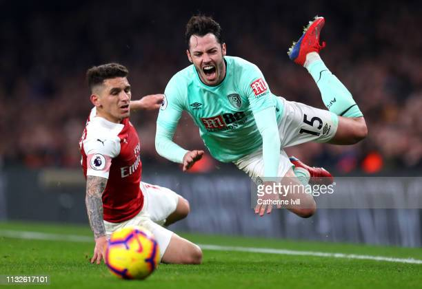 Lucas Torreira of Arsenal tackles Adam Smith of AFC Bournemouth during the Premier League match between Arsenal FC and AFC Bournemouth at Emirates...