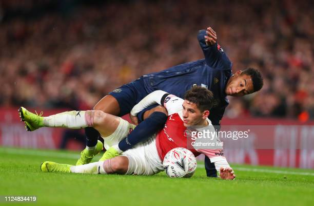 Lucas Torreira of Arsenal tangles with Jesse Lingard of Manchester United during the FA Cup Fourth Round match between Arsenal and Manchester United...