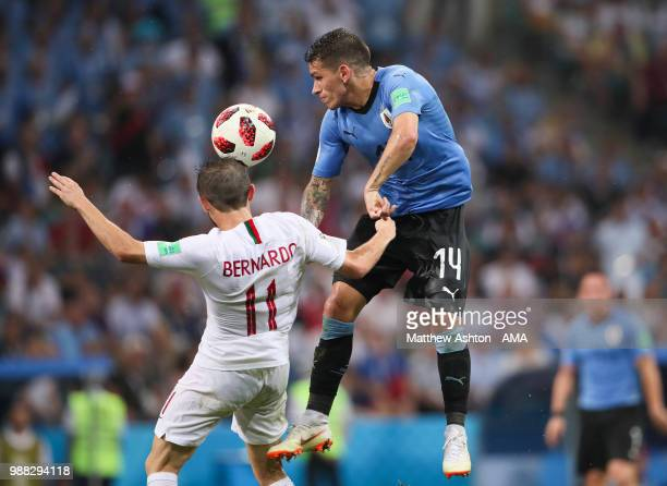 Lucas Torreira of Uruguay competes with Bernardo Silva of Portugal during the 2018 FIFA World Cup Russia Round of 16 match between Uruguay and...