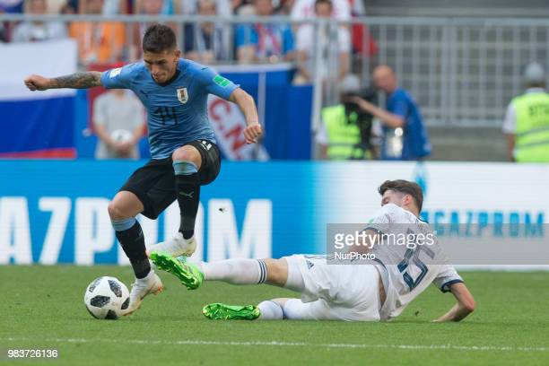 Lucas Torreira of Uruguay vies Alexey Miranchuk of Russia during the 2018 FIFA World Cup Russia group A match between Uruguay and Russia at Samara...