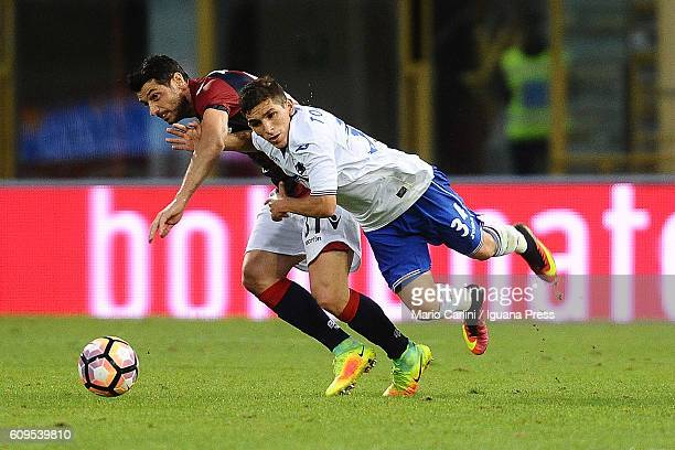 Lucas Torreirs of UC Sampdoria competes the ball with Blerim Dzemaili of Bologna FC during the Serie A match between Bologna FC and UC Sampdoria at...