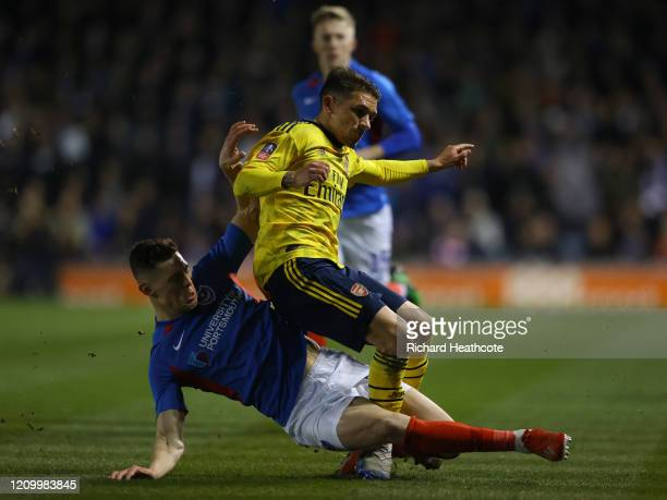 Lucas Torriera of Arsenal is tackled by James Bolton of Portsmouth and goes off injured during the FA Cup Fifth Round match between Portsmouth and...