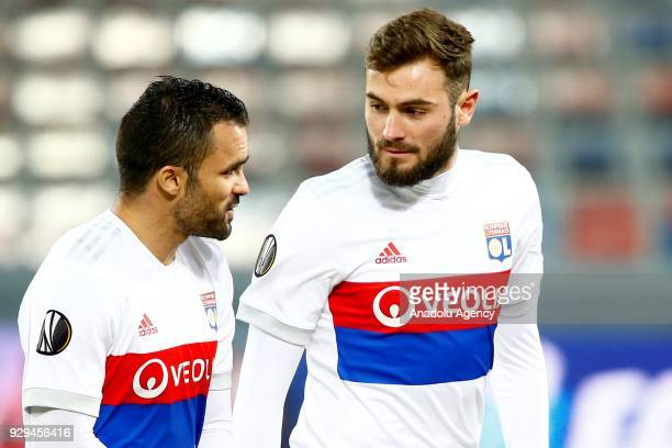 Lucas Tousart and Jérémy Morel of Olympique Lyonnais are seen during the UEFA Europa League round of 16 first leg soccer match between CSKA Moscow...