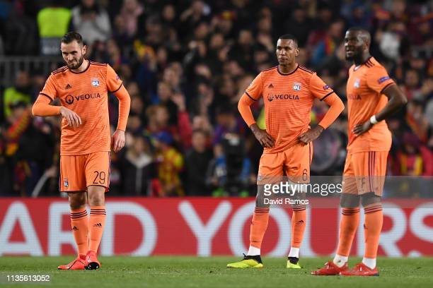 Lucas Tousart, Marcelo and Tanguy Ndombele of Olympique Lyonnais look dejected as Barcelona score their fifth goal during the UEFA Champions League...