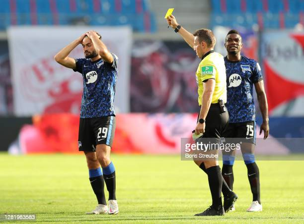 Lucas Tousart of Hertha Berlin is shown the yellow card during the Bundesliga match between RB Leipzig and Hertha BSC at Red Bull Arena on October...
