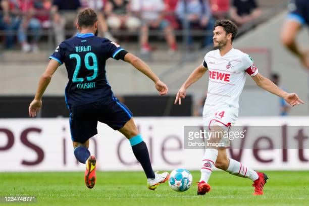 Lucas Tousart of Hertha BSC and Jonas Hector of 1.FC Koeln battle for the ball during the Bundesliga match between 1. FC Koeln and Hertha BSC at...