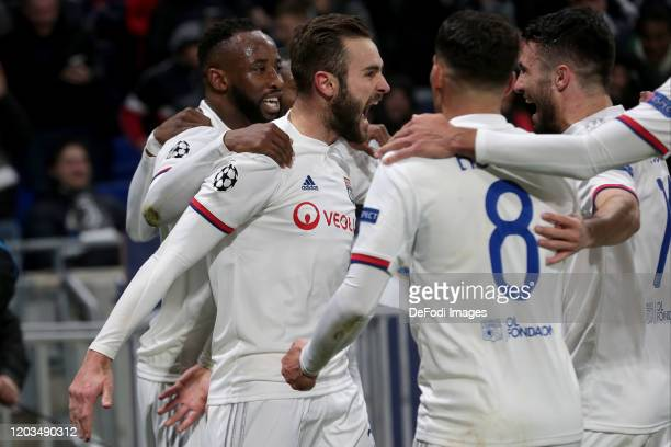 Lucas Tousart of Olympique Lyon celebrates after scoring his team's first goal with teammates during the UEFA Champions League round of 16 first leg...