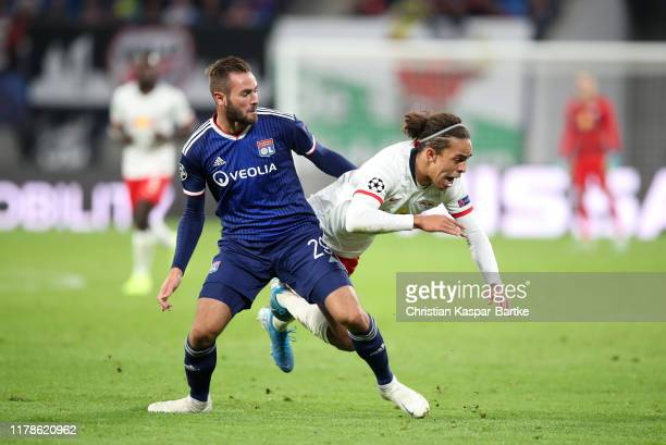 Lucas Tousart of Olympique Lyon is tackled by Yussuf Poulsen of RB Leipzig during the UEFA Champions League group G match between RB Leipzig and...