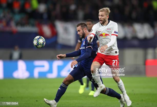 Lucas Tousart of Olympique Lyon looks to break past Konrad Laimer of RB Leipzig during the UEFA Champions League group G match between RB Leipzig and...