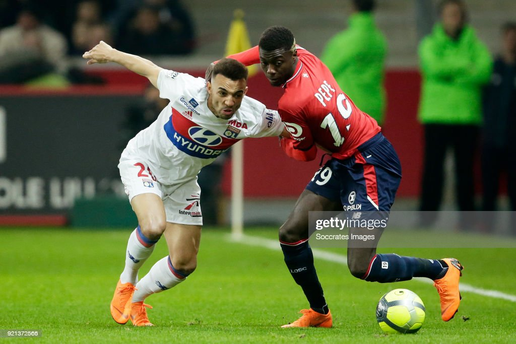 Lucas Tousart of Olympique Lyon, Nicolas Pepe of Lille during the French League 1 match between Lille v Olympique Lyon at the Stade Pierre Mauroy on February 18, 2018 in Lille France