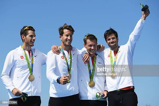 Lucas Tramer of Switzerland Simon Schuerch of Switzerland Simon Niepmann of Switzerland and Mario Gyr of Switzerland celebrate winning gold in the...