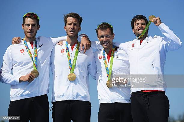 Lucas Tramer of Switzerland Simon Schuerch of Switzerland Simon Niepmann of Switzerland and Mario Gyr of Switzerland celebrate winning gold in the...