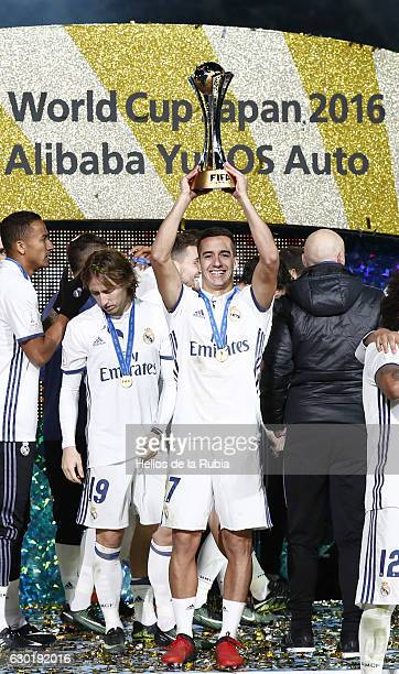 Lucas Vasquez poses with the trophy of champions during the FIFA Club World Cup Final match between Real Madrid and Kashima Antlers at International...