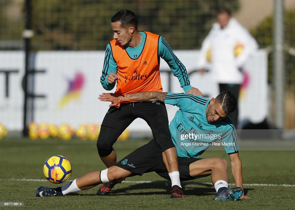 Lucas Vazquez (L) and Dani Ceballos of Real Madrid in action during a training session at Valdebebas training ground on December 22, 2017 in Madrid, Spain.