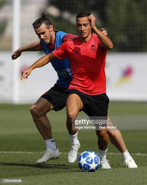 Lucas Vazquez and Gareth Bale of Real Madrid in action during a training session at Valdebebas training ground on September 18 2018 in Madrid Spain