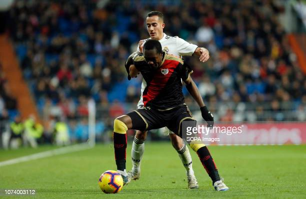 Lucas Vazquez and Luis Advincula are seen in action during the La Liga football match between Real Madrid and Rayo Vallecano at the Estadio Santiago...