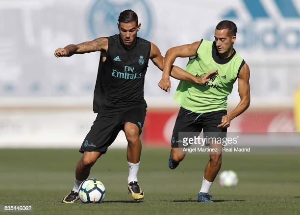 Lucas Vazquez and Theo Hernandez of Real Madrid in action during a training session at Valdebebas training ground on August 19 2017 in Madrid Spain