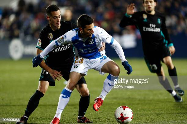 STADIUM LEGANéS MADRID SPAIN Lucas Vazquez competes for the ball with Omar during the match Jan 2018 Leganés CD and Real Madrid CF at Butarque...