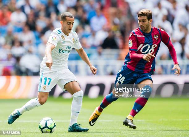 Lucas Vazquez Iglesias of Real Madrid fights for the ball with Jose Gomez Campana of Levante UD during the La Liga match between Real Madrid and...