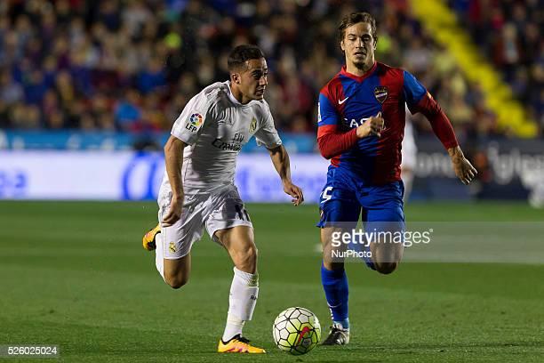 Lucas Vazquez of Real Madrid and 15 Nikolaos Karampelas del Levante ud during la liga match between Levante UD and Real Madrid CF at Ciutat de...