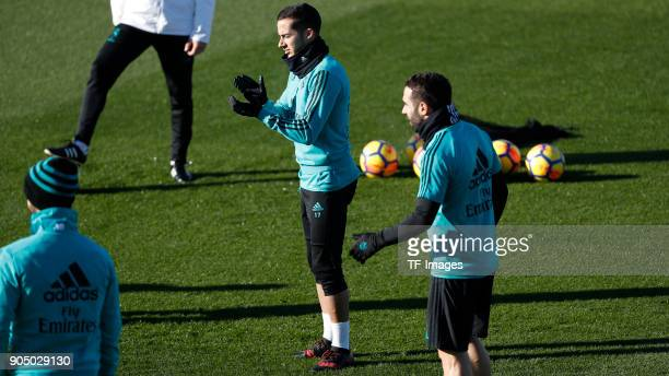 Lucas Vazquez of Real Madrid and Dani Carvajal of Real Madrid gesture during the Real Madrid training session on January 12 2018 in Madrid Spain
